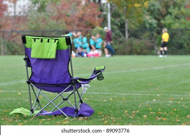 Folding chair at soccer field