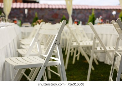 folding chairs at a wedding ceremony