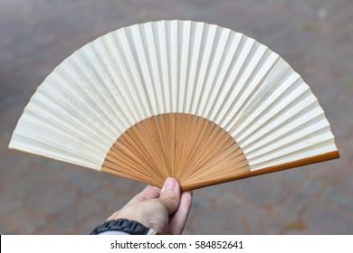 folding fan on hand