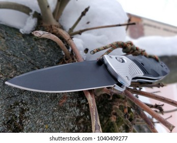 Folding knife with titanium handle stainless tactical camping dagger. Hunting EDC steel knife sharp metal tool blade pocket tactical accessory. portable safety utensil knive cutting survival edge.
