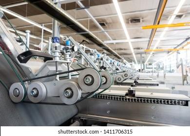 Folding Machine Output Hopper Stacks Wheels Closeup Industrial Machine Printing