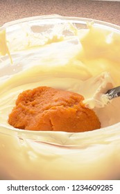 Folding raw pumpkin puree or pulp into batter for your special Thanksgiving dessert