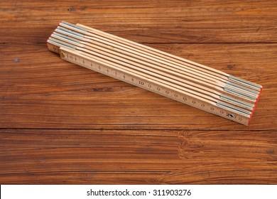 Folding rule on wood