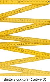 Folding ruler closeup on plain background