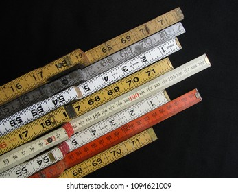 Folding rulers in metric and inch measurement represent concepts of accuracy, craftsmanship and precision.