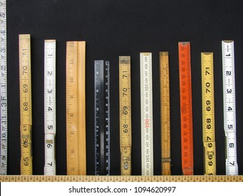 Folding rulers and scales in metric and inches form a bar chart and represent concepts of accuracy, measurement and accuracy.