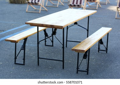 Folding table and benches on a street cafe