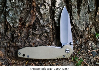 Folding tourist, camping knife with black blade and a handle made of fiberglass
