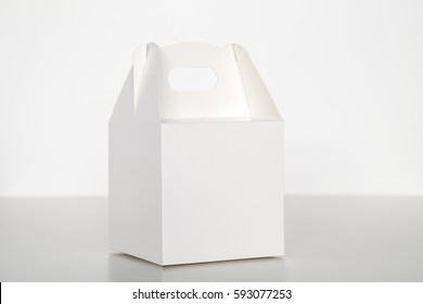 Folding white paper carton box for cakes, sweets and pastry, isolated on white background.
