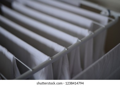 (foldout) drying rack: white shirts on the clotheshorse from the homemaker