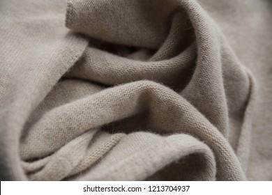 folds of beige wool
