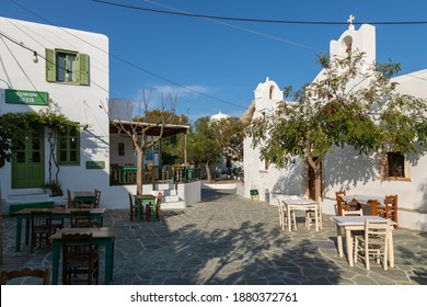 Folegandros Island, Chora, Greece - 23 September 2020: View of the main square of Chora with local restaurants. Outside tables for guests.