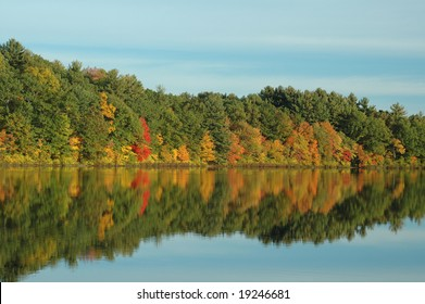 Foliage reflected on Johnson's Pond in Boxford, MA, on a clear fall day