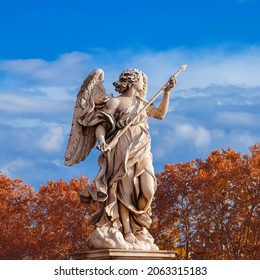 Foliage in Rome. Angel statue at the top of Sant'Angelo Bridge, erected in the 17th century, with beautiful atumnal leaves in the background
