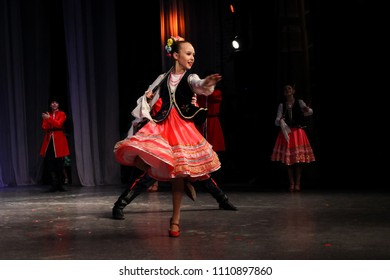"""Folk dance - children are dancing Russian dance in costumes on stage.  International contest-festival """"Seven steps"""" Choreography, Tomsk 3.12.17"""
