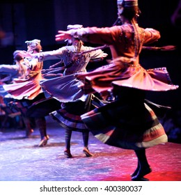 Folk dancers whirling