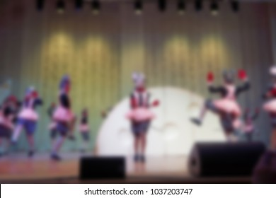 Folk dances of children and teens theme abstract blur background with bokeh effect.