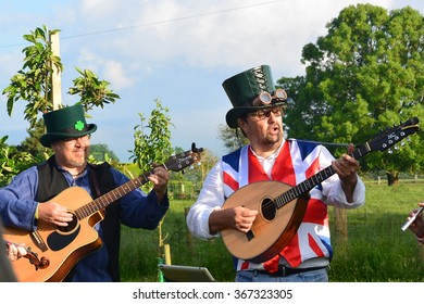 Folk group at an orchard Wassail on 20 June 2015 North Yorkshire, England. Apple trees are sung to and have cider poured on  to encourage a good crop for next year, according to English folklore.