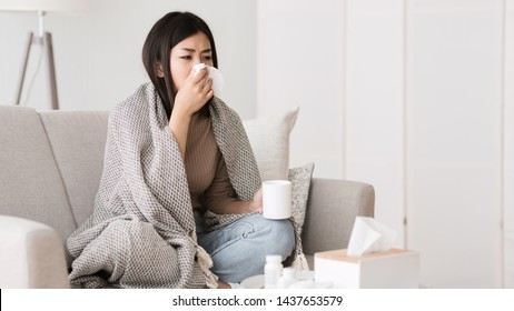 Folk Medicine. Sick Girl with Fever Wrapped in Blanket Drinking Hot Tea and Blowing Nose, Free Space