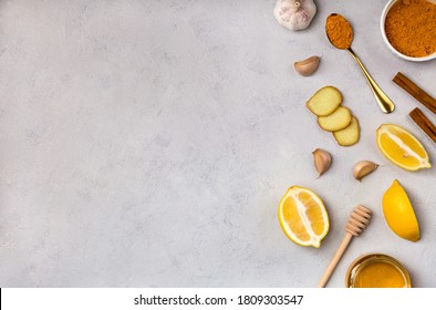 Folk remedies honey, garlic, ginger, turmeric, lemon. Ingridients for making drinks to prevent and treat colds and support the immune system. Herbal medicine an anti-inflammatory. Flat lay, copy space