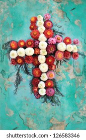 Folk style wreath on weathered turquoise wall, Guatemala