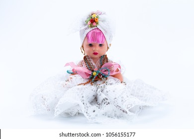 Folk traditional toy doll from a baiana do acaraje from Bahia with pink hair and white dress