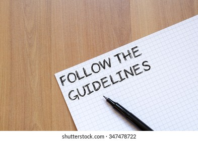 Follow the guidelines text concept write on notebook with pen