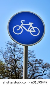 """""""Follow healthy way!""""  Vertical view of sign """"Bike path"""". Outdoor"""