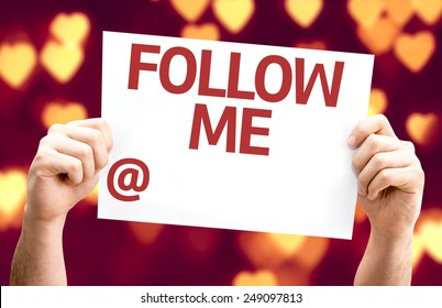 Follow Me with a copy space to put your profile card with heart bokeh background