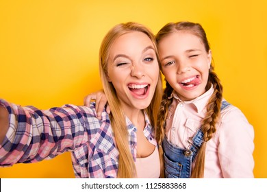 Follow me on social network! I want like! Close up photo picture portrait of candid careless pretty joyful funny funky cheerful glad hugging embracing girls making selfie isolated on bright background