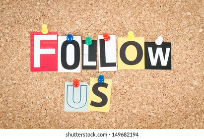 Follow Us, pinned on cork bulletin board.