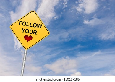 Follow your Heart motivational road sign. Making the right decisions in life or in career by following your heart