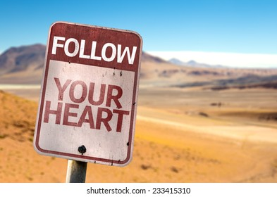 Follow Your Heart sign with a desert background