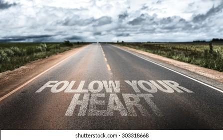 Follow Your Heart written on rural road