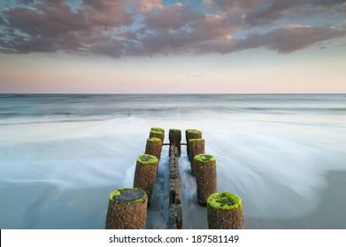 Folly Beach Charleston South Carolina Erosion Control Timber Groin at Sunset