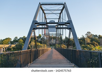Folsom, CA - June 14, 2019: Folsom Historic Truss Bridge in the early morning. Currently serving as a bike and pedestrian crossing across American River.