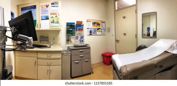 FOLSOM, CA, USA - AUG 15, 2018: Kaiser Permanente Medical Doctor office , with hospital equipment, bed, monitor.