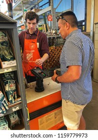FOLSOM, CA, USA - AUG 18, 2018: The Home Depot Store interior, man paying at cash register .