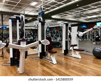 FOLSOM, CA, USA - JUN 4, 2019: Lifetime Fitness gym workout area for weight lifting.