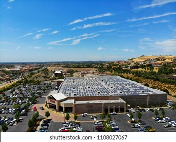 FOLSOM, CA, USA - June 2, 2018: Aerial drone view of Costco warehouse and outside parking lot on sunny summer day :