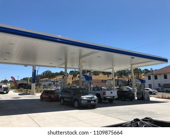 FOLSOM, CA, USA - June 2, 2018:  gas Station with cards pumping fuel