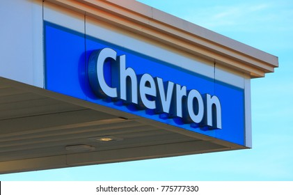FOLSOM, CA, USA - SEP 15, 2017: Chevron Gas Station logo, outside sign. Business Brand on store front wall.
