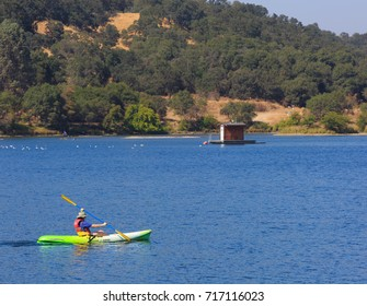 FOLSOM, CA, USA - SEP 18, 2017: Lake Natoma, the smaller of two lakes, recreational area for people to kayak, stand up, canoeing, swimming, paddle boarding. Sacramento State University Aquatic Center