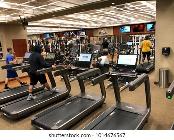 FOLSOM, USA - JAN 30, 2018: cardio machines at lifetime fitness gym with people exercising