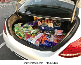 FOLSOM, USA - SEP 13, 2017: Car trunk filled with heathy raw vegan fruits and vegetables after a Costco shopping spree.