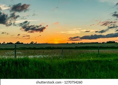 Fond du Lac, Wisconsin / United States - June 1, 2016:  Midwestern summer sunset near Lake Winnebago in Eastern Wisconsin