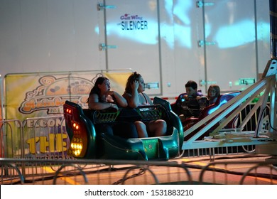 Fond du Lac, Wisconsin / USA - July 17th, 2019: Many adults and kids from the Fond du Lac, Wisconsin area came out to ride on the Scrambler fair ride during the night at Fond du Lac's County fair.