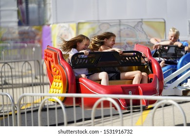 Fond du Lac, Wisconsin / USA - July 17th, 2019: Many local kids of the Fond du Lac area came out to ride on the scrambler fair ride at Fond du Lac's county Fair.