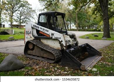 Fond du Lac, Wisconsin / USA - October 14th, 2019: Bobcat Front track Skid loader sitting unused.