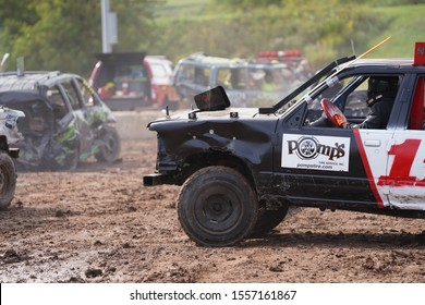 Fond du Lac, Wisconsin / USA - July 21st, 2019: Many Wreck broken down vehicles smash and run into each other in a derby.